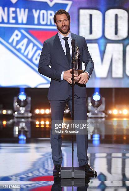 Dominic Moore of the New York Rangers speaks onstage after winning the Bill Masterson Memorial Trophy during the 2014 NHL Awards at the Encore...