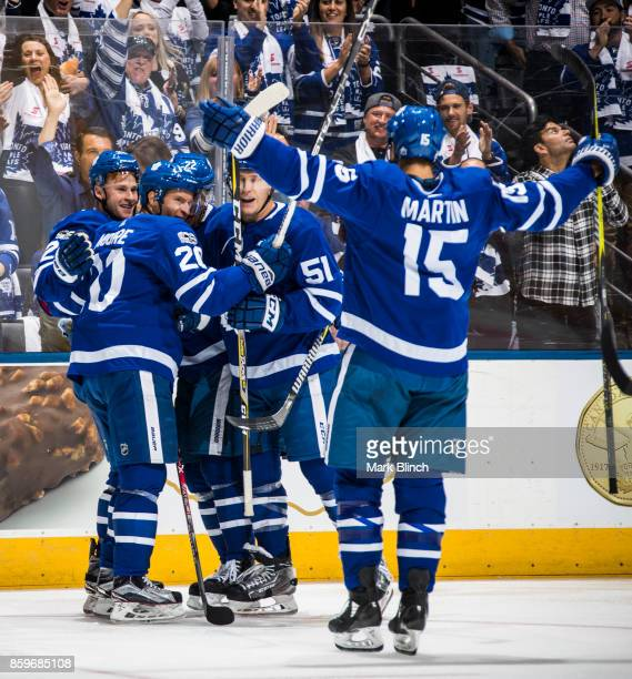 Dominic Moore of the Toronto Maple Leafs celebrates his goal with teammates Connor Brown Nikita Zaitsev Jake Gardiner and Matt Martin against the New...