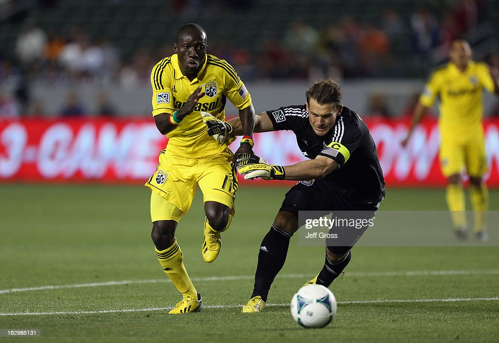 Dominic Oduro #11 of Columbus Crew and goalkeeper Dan Kennedy #1 of Chivas USA fight for the ball in the first half at The Home Depot Center on March 2, 2013 in Carson, California. The play resulted in an offsides call.