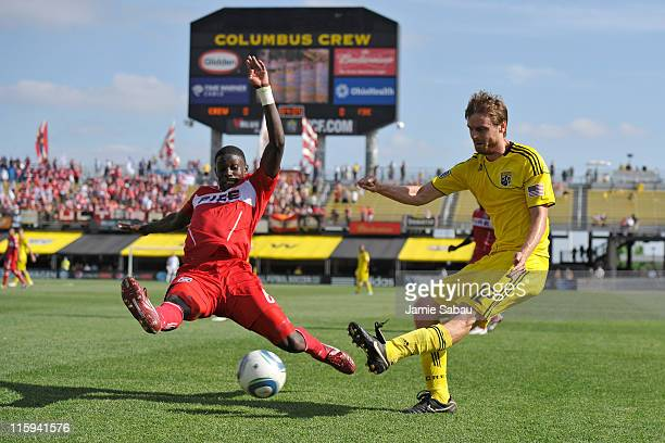 Dominic Oduro of the Chicago Fire attempts to block a shot from Eddie Gaven of the Columbus Crew in the second half on June 12 2011 at Crew Stadium...