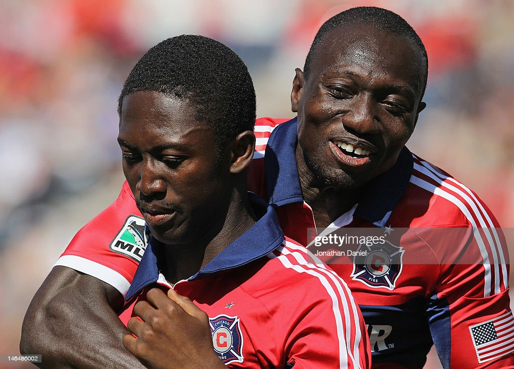 Dominic Oduro #8 of the Chicago Fire (R) hugs teammate Patrick Nyarko #14 after Nyarko scored a goal early in the game against the New York Red Bulls during an MLS match at Toyota Park on June 17, 2012 in Bridgeview, Illinois.