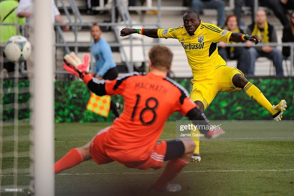 Dominic Oduro #11 of the Columbus Crew kicks the ball past goalkeeper Aaron Schoenfeld #18 of the Columbus Crew for a goal in the second half on April 6, 2013 at Crew Stadium in Columbus, Ohio. Columbus and Philadelphia played to a 1-1 tie.