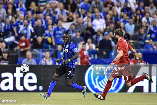 Dominic Oduro of the Montreal Impact and Drew Moor of the Toronto FC run after the ball during leg one of the MLS Eastern Conference finals at...