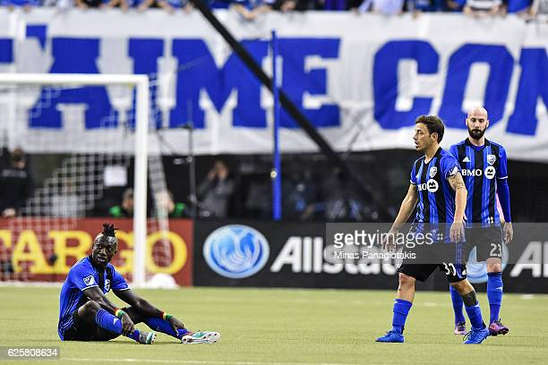 Dominic Oduro of the Montreal Impact sits on the pitch as teammate Hernan Bernardello walks towards him during leg one of the MLS Eastern Conference...