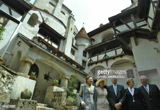 Dominic of Habsburg a New York architect and members of his family pose for a picture in the courtyard of the Bran Castle known as Dracula Castle...