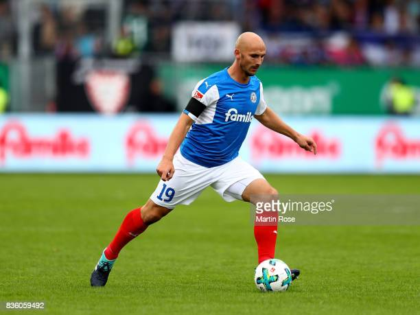 Dominic Peitz of Kiel runs with the ball during the Second Bundesliga match between Holstein Kiel and SpVgg Greuther Fuerth at HolsteinStadion on...