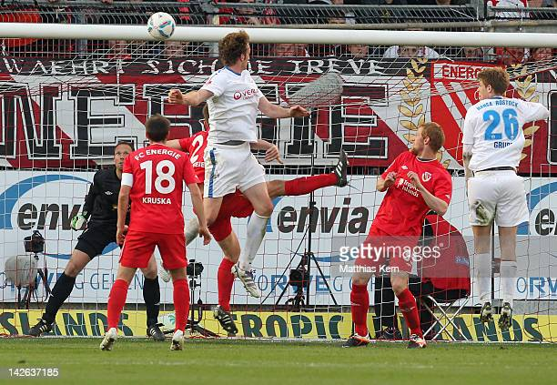 Dominic Peitz of Rostock scores the first goal during the Second Bundesliga match between FC Energie Cottbus and FC Hansa Rostock at Stadion der...