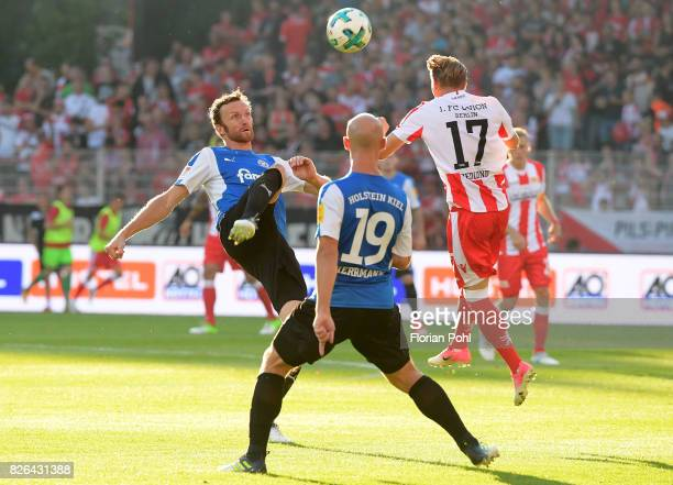 Dominic Peitz Patrick Hermann of Kieler SV Holstein and Simon Hedlund of 1 FC Union Berlin during the game between Union Berlin and Kieler SV...