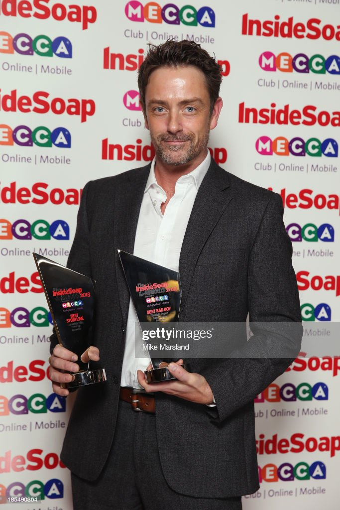 Dominic Power poses with the Best Bad Boy Award as he attends The Inside Soap Awards at The Ministry of Sound on October 21, 2013 in London, England.