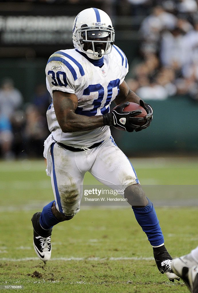 Dominic Rhodes #30 of the Indianapolis Colts carries the ball against the Oakland Raiders during an NFL football game at The Oakland-Alameda County Coliseum December 26, 2010 in Oakland, California. The Colts won the game 31-26.