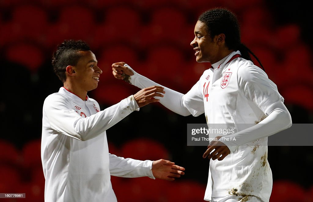 Dominic Samuel (R) of England U19 celebrates his goal with team-mate Josh Murphy during the International U19 match between England and Scotland at the Keepmoat Stadium on February 5, 2013 in Doncaster, England.