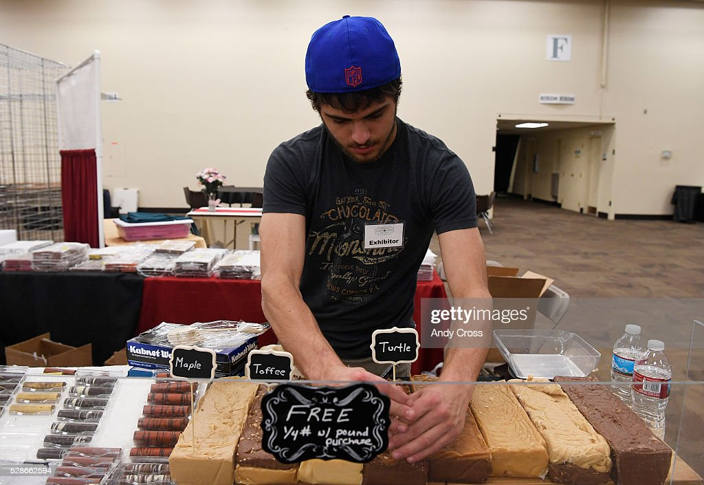 Dominic Sardella with the Chocolate Moonshine Company out of Colorado Springs Colorado sets up the booth for the Colorado Chocolate Festival at the Denver Mart May 06, 2016.