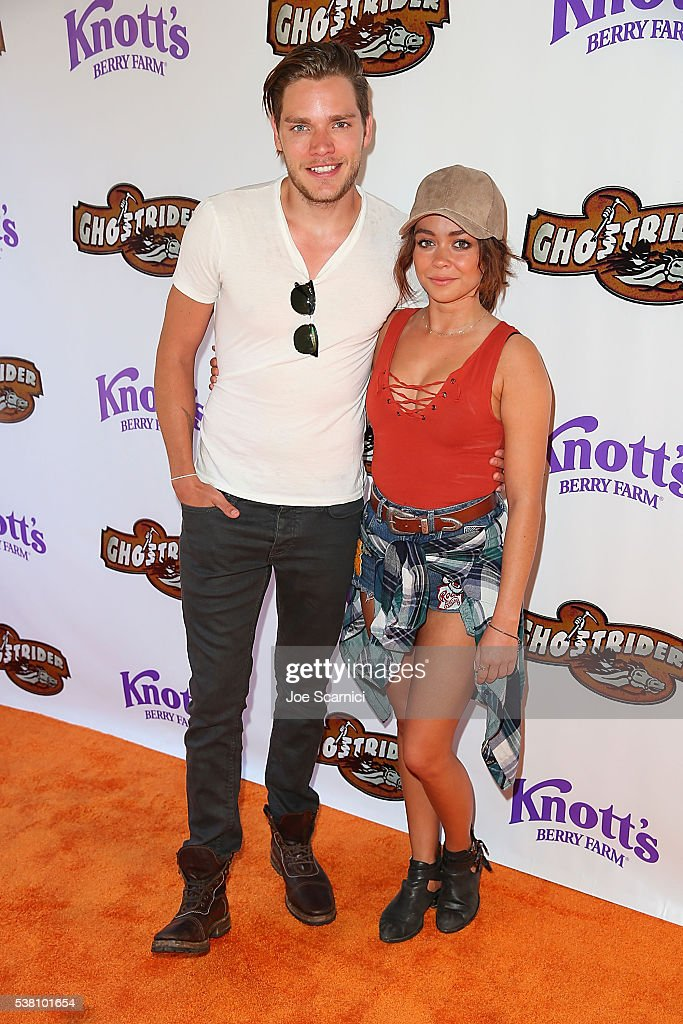 Dominic Sherwood and Sarah Hyland attend the GhostRider Reopening at Knott's Berry Farm on June 4 2016 in Buena Park California