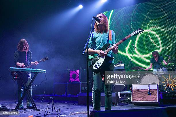 Dominic Simper Kevin Parker and Julien Barbagallo of Tame Impala perform on stage at Brixton Academy on October 30 2012 in London United Kingdom