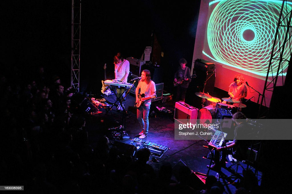 Dominic Simper,Nick 'Paisley Adams' Allbrook ,Kevin Parker,Jay 'Gumby' Watson ,and Julien Barbagallo of Tame Impala performs at Headliners Music Hall on March 2, 2013 in Louisville, Kentucky.
