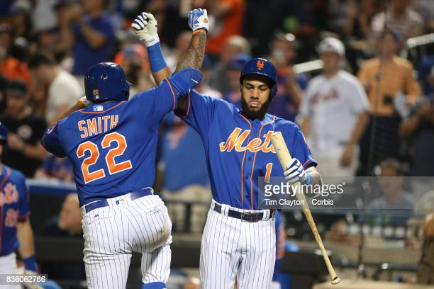 Dominic Smith of the New York Mets celebrates his sole home run int he eight inning with team mate Amed Rosario of the New York Mets during the Miami...