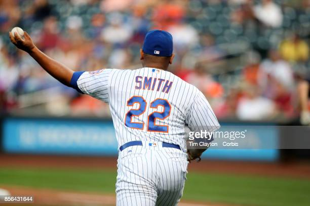 Dominic Smith of the New York Mets fielding a bunt during the Atlanta Braves Vs New York Mets MLB regular season game at Citi Field Flushing Queens...