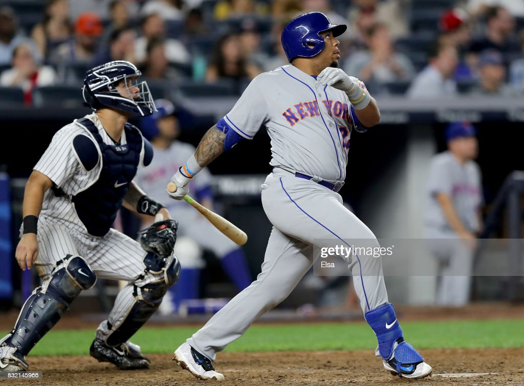 Dominic Smith #22 of the New York Mets hits a two run home run as Gary Sanchez #24 of the New York Yankees defends in the seventh inning during interleague play on August 15, 2017 at Yankee Stadium in the Bronx borough of New York City.