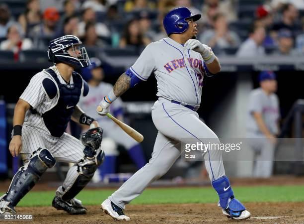 Dominic Smith of the New York Mets hits a two run home run as Gary Sanchez of the New York Yankees defends in the seventh inning during interleague...