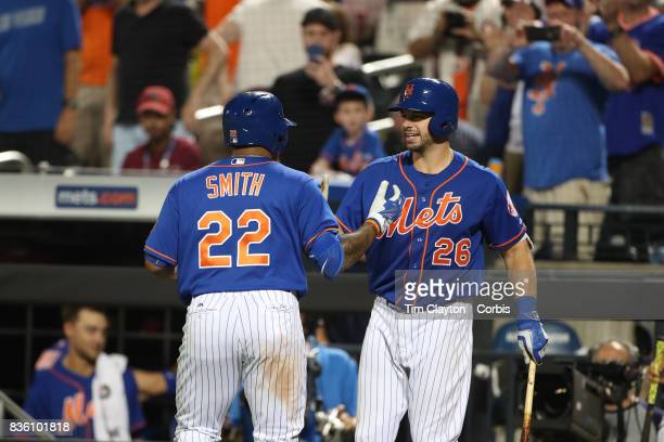 Dominic Smith of the New York Mets is congratulated by Kevin Plawecki of the New York Mets after hitting his first home run at Citi Filed during the...