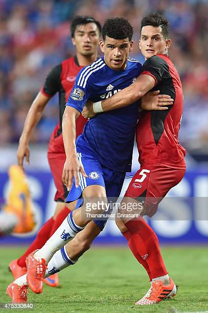 Dominic Solanke of Chelsea FC and Mika Chunuonsee of Thailand AllStars competes during the international friendly match between Thailand AllStars and...