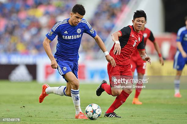 Dominic Solanke of Chelsea FC and Yuthajak Konjan of Thailand national team competes for the ball during the international friendly match between...