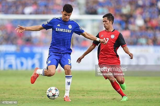 Dominic Solanke of Chelsea FC competes for the ball with Chutipon Tongtae of Thailand national team during the international friendly match between...
