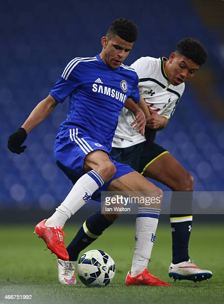Dominic Solanke of Chelsea is tackled by Chris Paul of Tottenham Hotspur during the FA Youth Cup Semi Final Second Leg match between Chelsea v...