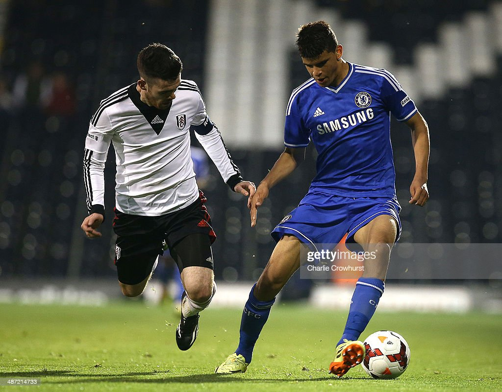 Dominic Solanke of Chelsea tries to get past Liam Donnelly of Fulham during the FA Youth Cup Final: First Leg match between Fulham and Chelsea at Craven Cottage on April 28, 2014 in London, England.