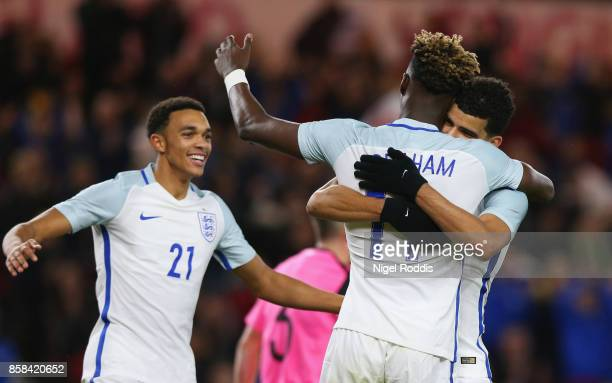 Dominic Solanke of England celebrates as he scores their third goal with Tammy Abraham and Trent AlexanderArnold during the UEFA European Under 21...