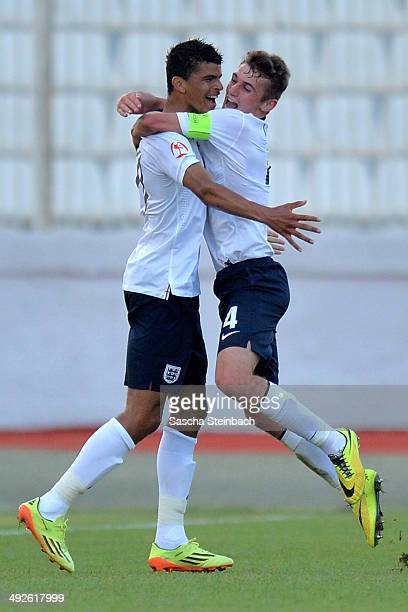 Dominic Solanke of England celebrates with team mate Ryan Ledson after scoring the opening goal during the UEFA Under17 European Championship 2014...