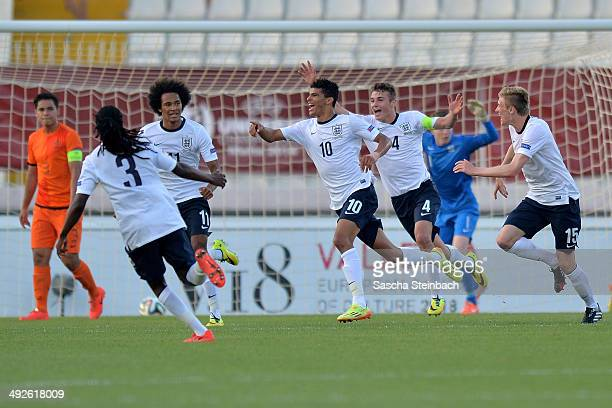 Dominic Solanke of England celebrates with team mates after scoring the opening goal during the UEFA Under17 European Championship 2014 final match...