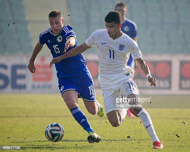 Dominic Solanke of England competes for the ball with Marin Popovic during the European Under 21 Qualifier match between Bosnia and Herzegovina U21...
