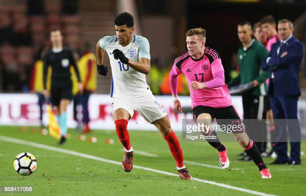 Dominic Solanke of England evades Christopher Cadden of Scotland during the UEFA European Under 21 Championship Group 4 Qualifier between England and...