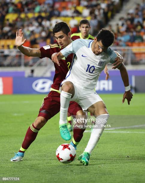 Dominic Solanke of England holds off Williams Velasquez of Venezuela during the FIFA U20 World Cup Korea Republic 2017 Final between Venezuela and...