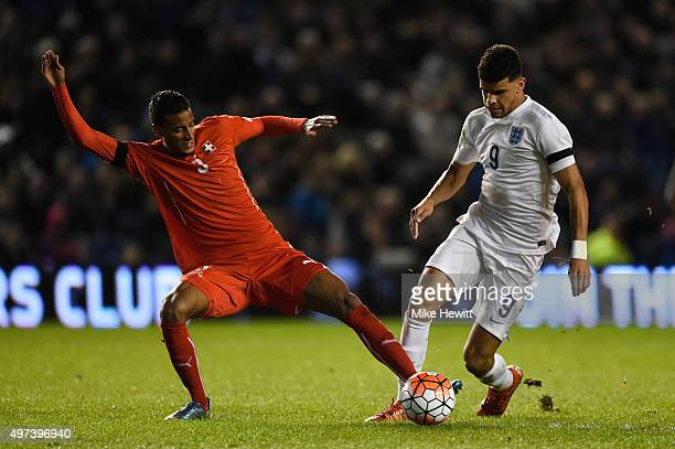 Dominic Solanke of England is challenged by Martin Angha of Switzerland during a European Under 21 Qualifier between England U21 and Switzerland U21...