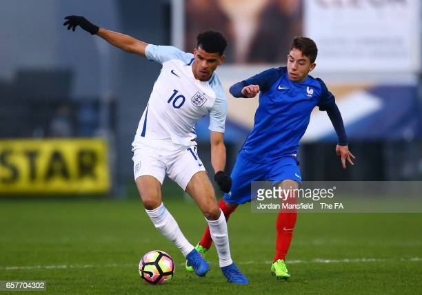 Dominic Solanke of England is pursued by Maxime Lopez of France during the UEFA U20 International Friendly match between France and England at Stade...