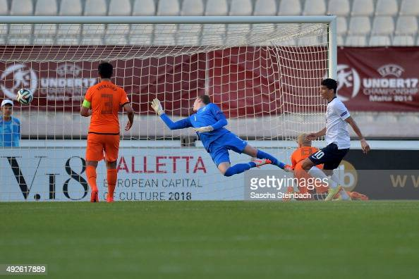 Dominic Solanke of England scores the opening goal during the UEFA Under17 European Championship 2014 final match between England and Netherlands at...
