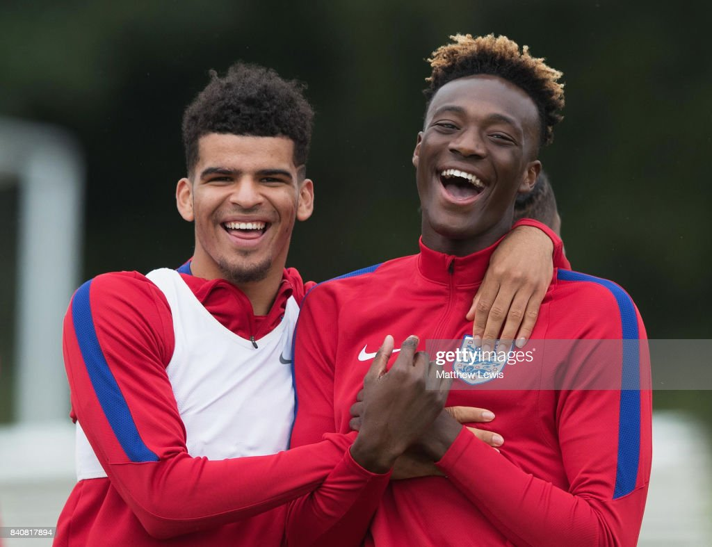 Dominic Solanke (L) of England shares a joke with team mate Tammy Abraham during an England Under 21 training session at St George's Park on August 30, 2017 in Burton-upon-Trent, England.