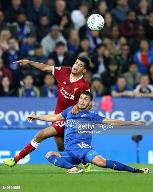 Dominic Solanke of Liverpool and Aleksander Dragovic of Leicester City battle for possession during the Carabao Cup Third Round match between...