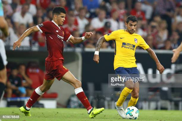 Dominic Solanke of Liverpool and Augusto Fernandez of Atletico de Madrid during the Audi Cup 2017 match between Liverpool FC and Atletico Madrid at...