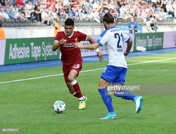 Dominic Solanke of Liverpool competes with Marvin Plattenhardt of Hertha BSC during the preseason friendly match between Hertha BSC and FC Liverpool...