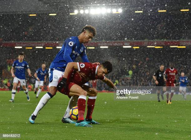 Dominic Solanke of Liverpool competes with Mason Holgate of Everton during the Premier League match between Liverpool and Everton at Anfield on...