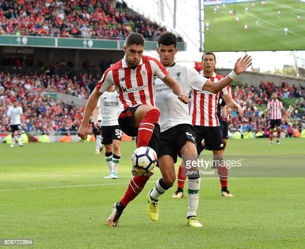 Dominic Solanke of Liverpool competes with Unai Nunez of Athletic Bilbao during a pre season friendly match between Liverpool and Athletic Bilbao at...