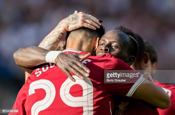 Dominic Solanke of Liverpool FC celebrates with team mates after scoring his team's first goal during the Preseason Friendly match between Hertha BSC...