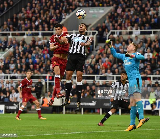 Dominic Solanke of Liverpool goes up with Jamaal Lascelles of Newcastle United during the Premier League match between Newcastle United and Liverpool...