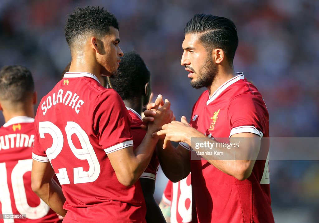Dominic Solanke (L) of Liverpool jubilates with team mate Emre Can after scoring the first goal during the pre season friendly match between Hertha BSC and FC Liverpool at Olympiastadion on July 29, 2017 in Berlin, Germany.