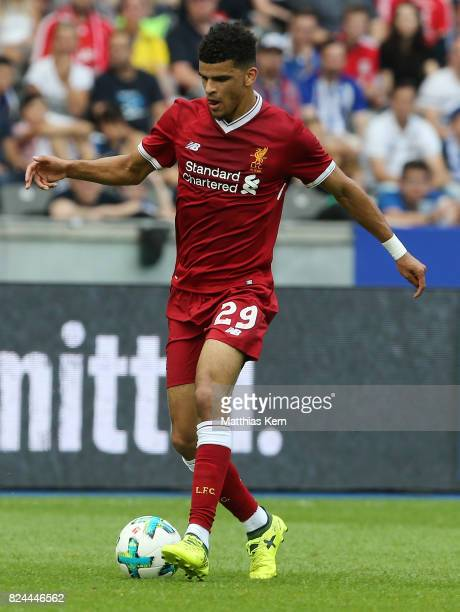 Dominic Solanke of Liverpool runs with the ball during the pre season friendly match between Hertha BSC and FC Liverpool at Olympiastadion on July 29...