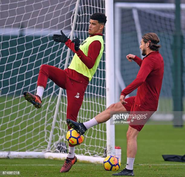 Dominic Solanke with Adam Lallana of Liverpool at Melwood Training Ground on November 15 2017 in Liverpool England