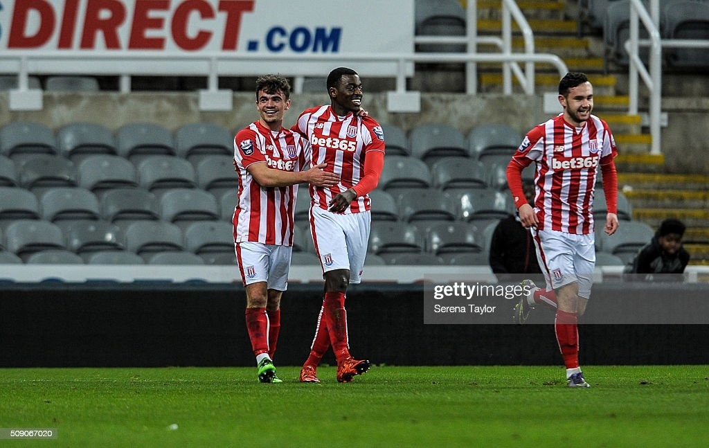 Dominic Telford of Stoke City (L) celebrates with teammate Joel Taylor (C) after scoring the opening penalty during the Barclays Premier League U21 match between Newcastle United and Stoke City at St.James' Park on February 8, 2016, in Newcastle upon Tyne, England.